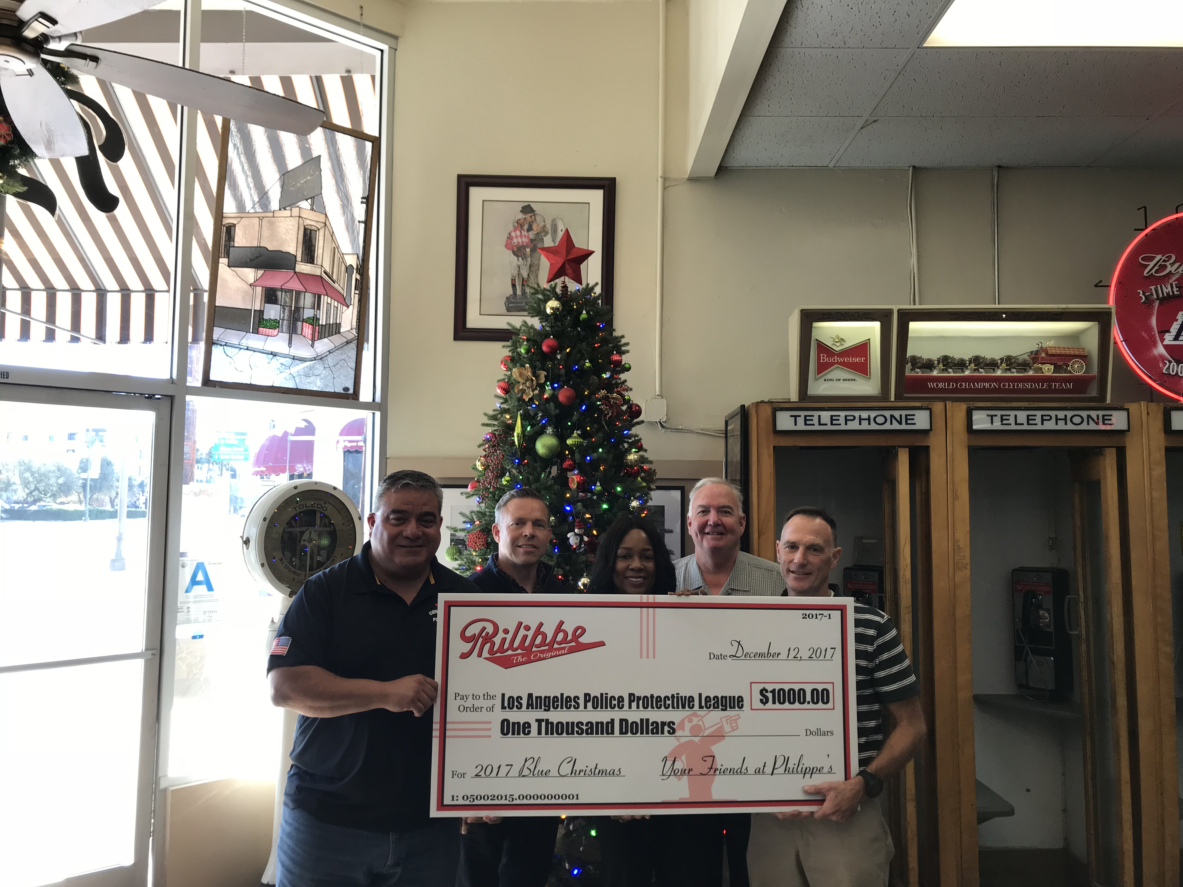 Philippe's Donates $1k to LAPPL's Blue Christmas